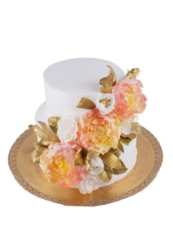 Свадебный торт с желто-оранжевыми цветами