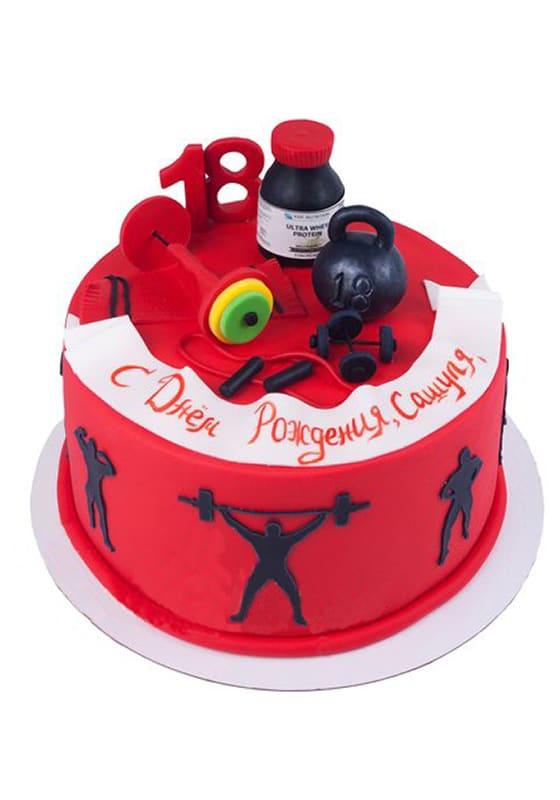 Красный торт с гантелями и гирями